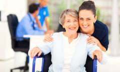 caregiver smiling with a senior woman