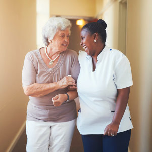 a female caregiver with a senior woman