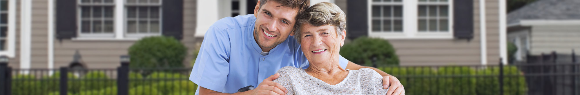 male caregiver with a senior woman