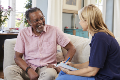 caregiver having a conversation with a senior man