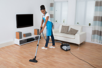 caregiver cleaning the living room